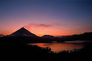 Arenal Volcano at sunrise. Lake Arenal in foreground. Costa Rica.<br />