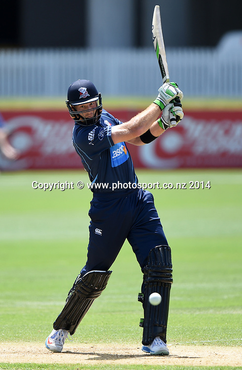 Auckland's Martin Guptill bating during his century innings at the Ford Trophy one day cricket match between Auckland Aces and Wellington Firebirds at the Eden Park Outer Oval, Auckland, New Zealand. Saturday 27 December 2014. Photo: Andrew Cornaga/www.Photosport.co.nz
