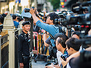 21 AUGUST 2015 - BANGKOK, THAILAND: Thai media photograph the Erawan Shrine Friday. The Bangkok Metropolitan Administration (BMA) held a religious ceremony Friday for the Ratchaprasong bomb victims. The ceremony started with a Brahmin blessing at Erawan Shrine, which was the target of a bombing Monday night. After the blessing people went across the street to the plaza in front of Central World mall for an interfaith religious service. Theravada Buddhists, Mahayana Buddhists, Muslims, Sikhs, Hindus, and Christians participated in the service. Life at the shrine, one of the busiest in Bangkok, is returning to normal. Friday the dancers and musicians who perform at the shrine resumed their schedules.     PHOTO BY JACK KURTZ