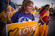 "23 JUNE 2012 - PHOENIX, AZ:  Members of the Unitarian Church picket the Maricopa County Jail in Phoenix. About 2,000 members of the Unitarian Universalist Church, in Phoenix for their national convention, picketed the entrances to the Maricopa County Jail and ""Tent City"" Saturday night. They were opposed to the treatment of prisoners in the jail, many of whom are not convicted and are awaiting trial, and Maricopa County Sheriff Joe Arpaio's stand on illegal immigration. The protesters carried candles and sang hymns.      PHOTO BY JACK KURTZ"