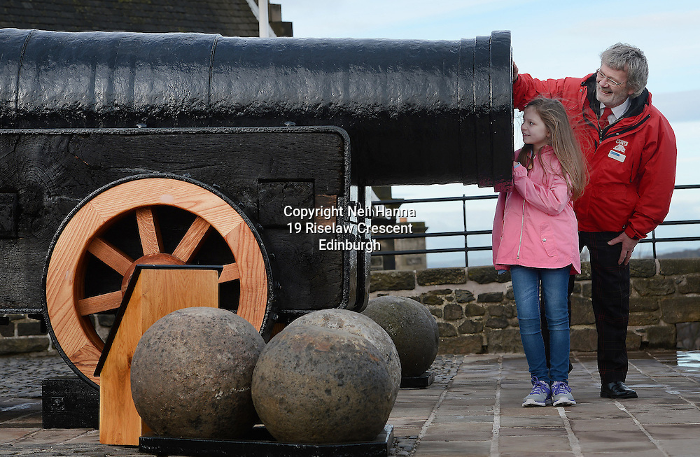 Edinburgh Castle Monday 23/05/2015<br /> <br /> MONS MEG RETURNS TO EDINBURGH CASTLE FOLLOWING MOT<br />  <br /> Mons Meg, the world's most famous medieval gun, was welcomed back to Edinburgh Castle this morning (23/03/15). The six tonne cannon has been undergoing specialist conservation work over the past two months at a secret location – the first time it has left the castle in over 30 years. Amongst the first visitors to inspect the works were Beth Graham, 9 from East Kilbride assisted by Edinburgh Castle guide, Frank Chambers.<br /> <br />  Neil Hanna Photography<br /> www.neilhannaphotography.co.uk<br /> 07702 246823