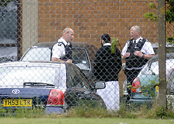 © Licensed to London News Pictures. 10/06/2013 Police talk to a man at the school today. Police on scene protecting Darul Uloom School today (10.06.2013) after a suspicious fire.  Four teenagers have been arrested. Photo credit :Grant Falvey/LNP