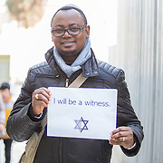 "Portraits of Jonny Daniels and pictures of people with an ""I am a witness"" poster at The Old City and The Kotel on January 11, 2015 in Jerusalem, Israel. (Photo by Elan Kawesch)"