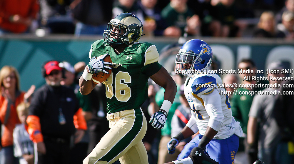 SHOT 10/12/13 2:47:46 PM - Colorado State's Kivon Cartwright #86 outraces San Jose State's Bene Benwikere #21 on his way to a receiving touchdown during their regular season Mountain West game at Hughes Stadium in Fort Collins, Co. San Jose State won the game 34-27. (Photo by Marc Piscotty / © 2013)