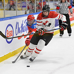 WHITBY, - Dec 14, 2015 -  Game #4 - Russia vs. Canada East at the 2015 World Junior A Challenge at the Iroquois Park Recreation Complex, ON. Sam Dunn #11 of Team Canada East keeps the puck from Maxim Bain #26 of Team Russia during the first period. <br /> (Photo: Shawn Muir / OJHL Images)
