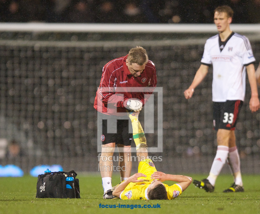 Picture by Alan Stanford/Focus Images Ltd +44 7915 056117<br /> 04/02/2014<br /> Stefan Scougall of Sheffield United gets treatment for cramp during the The FA Cup match at Craven Cottage, London