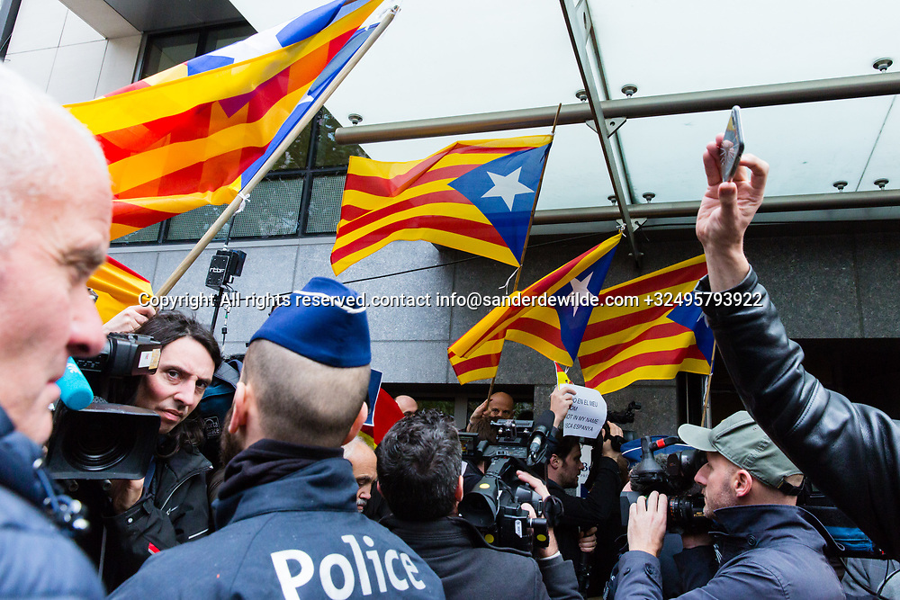 "Brussels Belgium 2017 Oktober 31 Catalonia's ousted president, Carles Puigdemont, said during a crowded press conference at the Brussels Press Centre to act ""in freedom and safety"", but not to seek political asylum.Police and demonstrators outside the press centre"