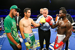 Los Angeles, CA - July 11, 2015: Michael Perez (brown trunks) and Luis Sanchez (red trunks) during their HBO Latino undercard bout at the Los Angeles Sports Arena in Los Angeles, CA.  Ed Mulholland for HBO Latino.