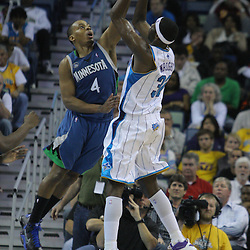 08 February 2009: New Orleans Hornets forward Julian Wright (32) shoots over Minnesota Timberwolves guard Randy Foye (4) during a 101-97 win by the New Orleans Hornets over the Minnesota Timberwolves at the New Orleans Arena in New Orleans, LA.