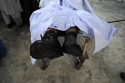 61017757<br /> A body is seen at a hospital in northwest Pakistan s Peshawar on Feb. 4, 2014. At least eight people were killed and 25 others injured on Tuesday evening as a blast hit a busy market in Peshawar, local media reported, Tuesday, 4th February 2014. Picture by  imago / i-Images<br /> UK ONLY