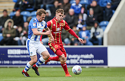 Tom Lapslie of Colchester United and Jake Hesketh of Milton Keynes Dons tussle for the ball - Mandatory by-line: Arron Gent/JMP - 27/04/2019 - FOOTBALL - JobServe Community Stadium - Colchester, England - Colchester United v Milton Keynes Dons - Sky Bet League Two