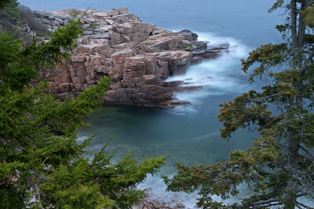 Monument Cove coastal photography fine art prints are available as museum quality photography prints, canvas prints, acrylic prints or metal prints. Prints may be framed and matted to the individual liking and room decor needs:<br /> <br /> http://juergen-roth.artistwebsites.com/featured/atop-of-maine-acadia-national-park-monument-cove-juergen-roth.html<br /> <br /> Gorgeous seacoast photography image of the granite shoreline at Monument Cove in Acadia National Park, Maine. I implemented the evergreen tree into the composition as a more appealing foreground feature to convey some sort of scale. <br /> <br /> Acadia National Park is a National Park located in the U.S. state of Maine. It reserves much of Mount Desert Island, and associated smaller islands, off the Atlantic coast. Originally created as Lafayette National Park in 1919, the first National Park East of the Mississippi, it was renamed Acadia in 1929. The park is one of the most visited wildlife areas in the United States and a paradise for every photographer and outdoor enthusiast. The park loop road provides easy access to many of the iconic photography subjects, such as Monument Cove, The Beehive, Sand Beach, Jordan Pond and the Bubbles, Bubble Pond, Otter Cliff to name only a few. The carriage roads and hiking trails provide further access to more remote locations where the park continues to inspire and unfolds its full magic. It is a heaven for macro, seascape, and landscape photography that makes for great wall art decoration. Especially sunrise and the light of the golden hours paint the sky in beautiful blue and orange and brings out the beauty of the pink granite rocks.<br /> <br /> Good light and happy photo making!<br /> <br /> My best,<br /> <br /> Juergen<br /> Art Prints: www.RothGalleries.com<br /> Image Licensing: www.ExploringTheLight.com<br /> Photo Blog: http://whereintheworldisjuergen.blogspot.com<br /> @NatureFineArt<br /> https://www.facebook.com/naturefineart