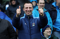 A Coventry City fan in the stands before kick off at the Stadium MK for for the Emirates FA Cup Fourth Round match
