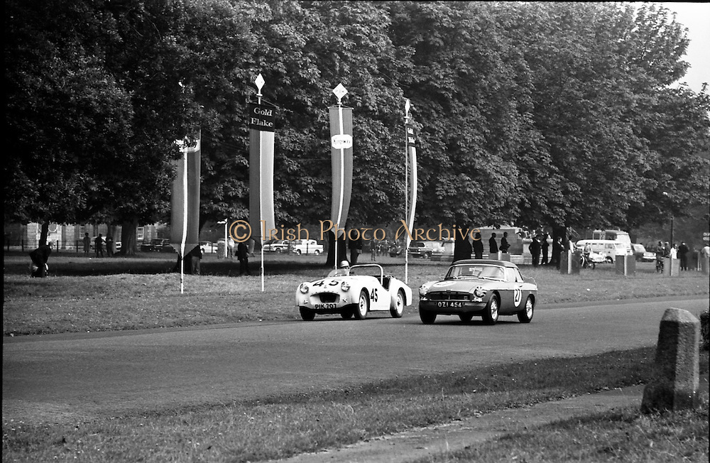 16/09/1967<br /> 09/16/1967<br /> 16 September 1967<br /> Phoenix Park Motor Racing, Kingsway Trophy Race, sponsored by Player and Wills (Ireland) Limited.  <br /> Image shows A. Hearn's T.R. 3 (45) and K.J. Farrell's M.G.B. (27).