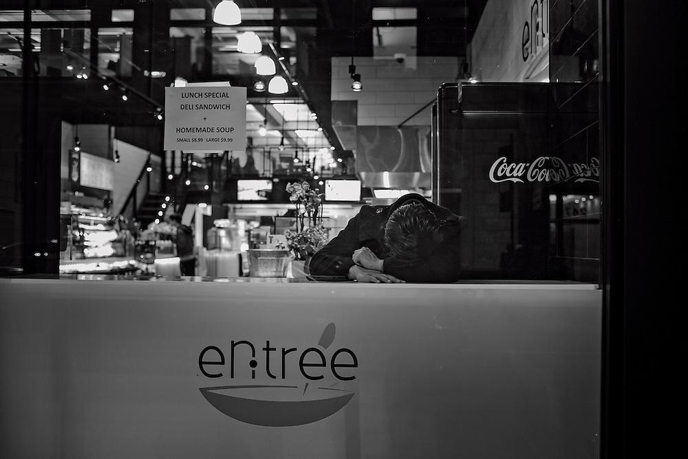 Man asleep in restaurant, New York, NY, US