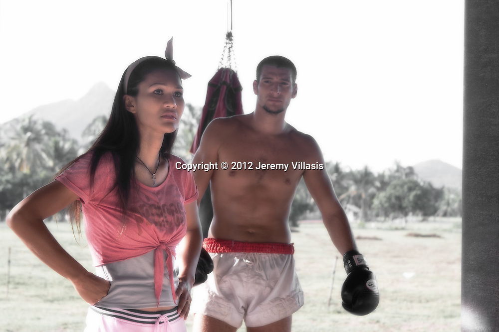 Nong Toom gives instructions to her students as fellow Muay Thai and MMA fighter, Yoann Gouaida, look on. The two have been friends for a decade and have been training together for 2 years. Finding success in Mixed Martial Arts, particularly among western practitioners, Muay Thai has become the de facto style of choice for many competitive fighters.