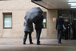 © Licensed to London News Pictures. 12/11/2015. London, UK. Tory peer, Lord Hanningfield (aka Paul White) arrives (hidden behind umbrella) at Southwark Crown Court in London where he is charged with false accounting in relation to claims for the daily allowance at the House of Lords. Lord Hanningfield is accused of 'clocking in' to Parliament and then leaving just minutes later in order to claim the daily attendance allowance of £300. Photo credit : Vickie Flores/LNP