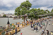 Looking across the South bank of the river Thames from the South Bank Centre to Waterloo Bridge, London.