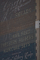 New York, New York City. Masonry mosaics on building facade.