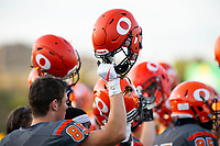 KELOWNA, BC - AUGUST 3:  Players raise helmets in the air for kick off against the Kamloops Broncos at the Apple Bowl on August 3, 2019 in Kelowna, Canada. (Photo by Marissa Baecker/Shoot the Breeze)