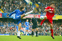 Fotball<br /> Premier League 2004/05<br /> Chelsea v Liverpool<br /> 3. oktober 2004<br /> Foto: Digitalsport<br /> NORWAY ONLY<br /> Chelsea's Alexey Smertin smashes the ball away as Liverpool's Xabi Alonso tries to shield himself.<br /> Photo:Jed Leicester/BPI (back page images)