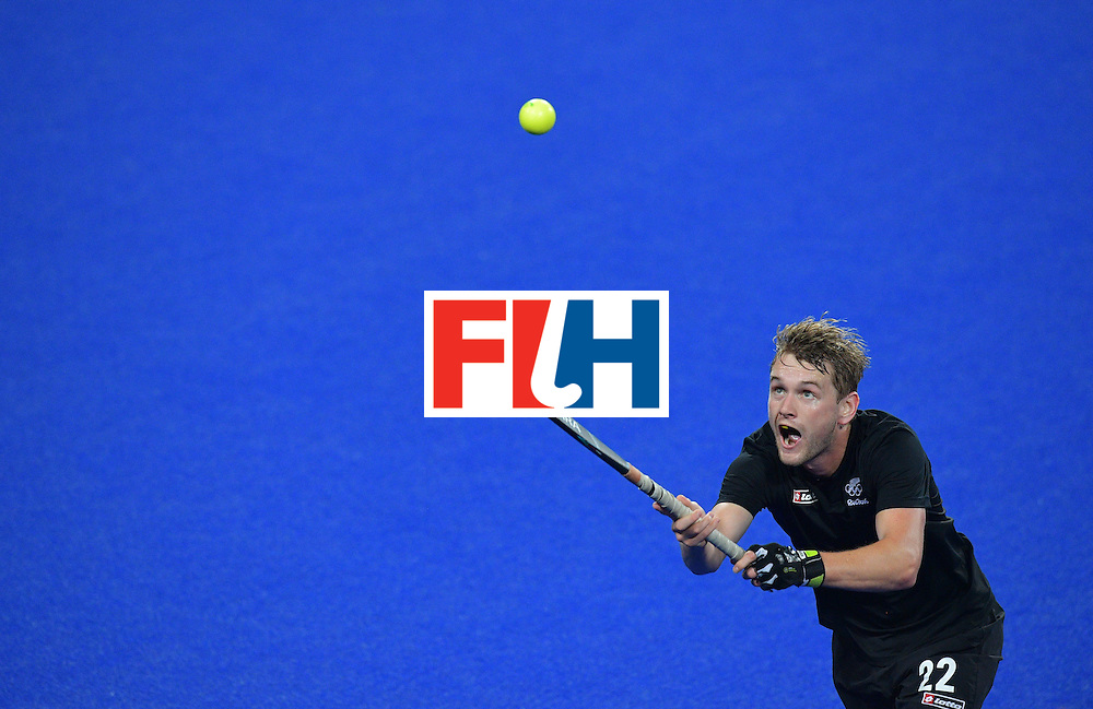 New Zealand's Blair Tarrant controls the ball during the men's field hockey New Zealand vs Brazil match of the Rio 2016 Olympics Games at the Olympic Hockey Centre in Rio de Janeiro on August, 10 2016. / AFP / Carl DE SOUZA        (Photo credit should read CARL DE SOUZA/AFP/Getty Images)