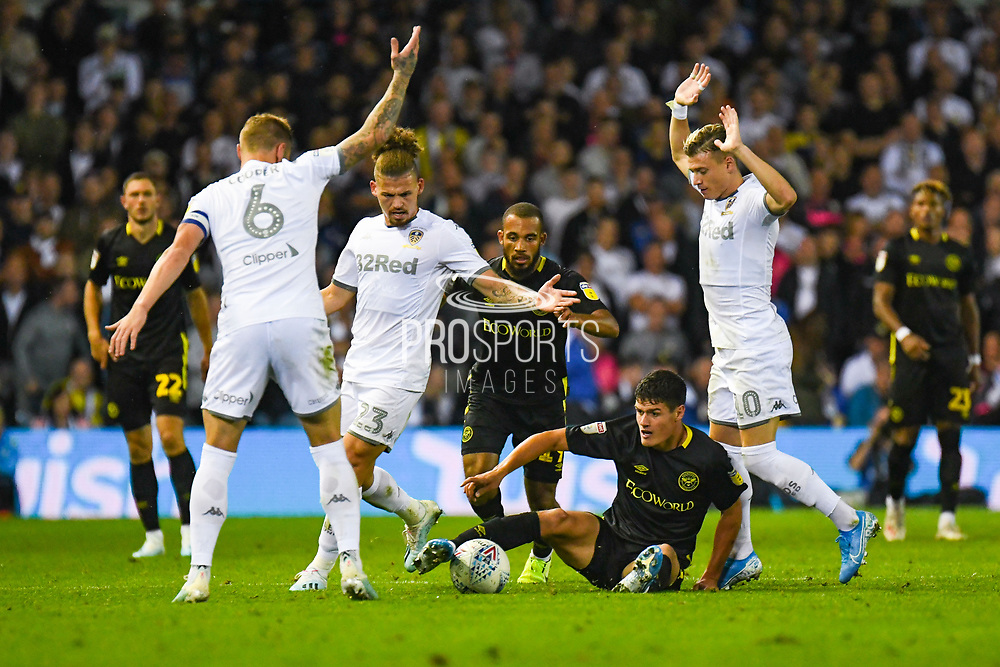 Brentford midfielder Christian Norgaard (6) Leeds United midfielder Kalvin Phillips (23) Leeds United defender Ezgjan Alioski (10) during the EFL Sky Bet Championship match between Leeds United and Brentford at Elland Road, Leeds, England on 21 August 2019.