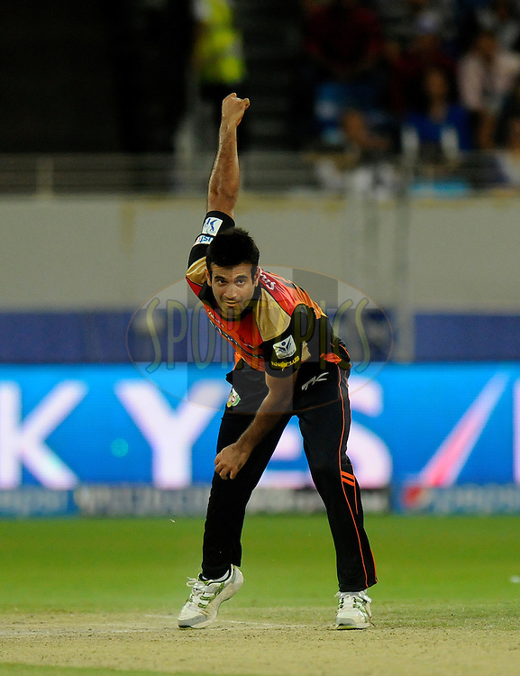Irfan Pathan of the Sunrisers Hyderabad bowls during match 20 of the Pepsi Indian Premier League Season 2014 between the Mumbai Indians and the Sunrisers Hyderabad held at the Dubai International Stadium, Dubai, United Arab Emirates on the 30th April 2014<br /> <br /> Photo by Pal Pillia / IPL / SPORTZPICS