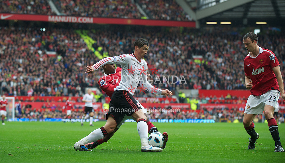 MANCHESTER, ENGLAND - Sunday, September 19, 2010: Liverpool's Fernando Torres and Manchester United's Patrice Evra during the Premiership match at Old Trafford. (Photo by David Rawcliffe/Propaganda)