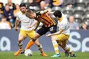 Hull City midfielder Markus Henriksen (22) beats Sheffield Wednesday midfielder George Boyd (21) and Sheffield Wednesday forward Fernando Forestieri (45) during the EFL Sky Bet Championship match between Hull City and Sheffield Wednesday at the KCOM Stadium, Kingston upon Hull, England on 14 April 2018. Picture by Mick Atkins.