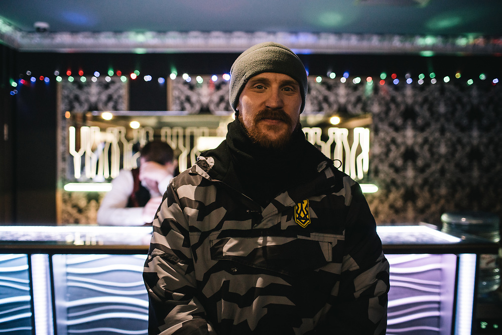 Kyiv, Ukraine, 6 February 2018. <br /> Samson, one of the members of the patrol poses in the lottery area they tried to close down. Behind him stands the local employee. <br /> A patrol of the Natsionalny Druzhyna tries to close what they call an illegal casino in the region of Boryspil. All the computer got turned off as soon as they entered and all the clients left. After a while, the patrol left and canceled their call to the police. <br /> <br /> Natsionalny Druzhyna (national brigades / patrols) are a volunteer branch of ultra-nationalist battalion &quot;Azov&quot; and of its political party &quot;Natsionalny Korpus (national body)&quot;. Created on January 28, Druzhyna's goal is to enforce civil security in Ukrainian streets aside from national police. Its methods as well as its position toward use of violence and respect of authority of the State are still unclear. Creation of Druzhyna and its first public actions stirred controversy within civil society and public opinion.<br /> <br /> &copy; Niels Ackermann / Lundi13