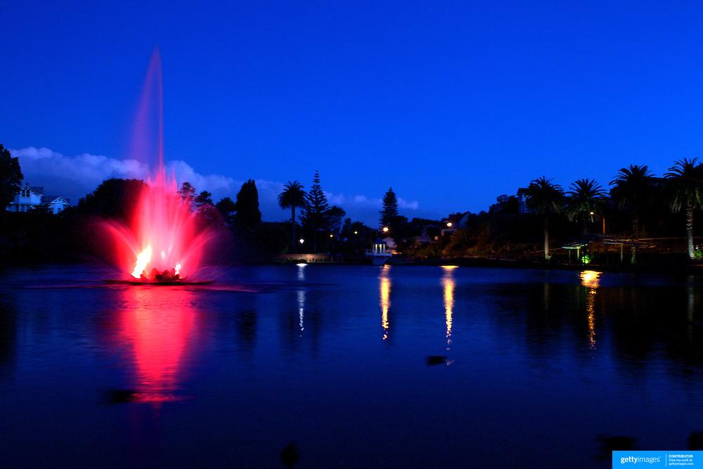 Dusk shot of coloured  lake fountain at Virginia Lake Park, Virginia Hill,  Wanganui. 28th December 2010. Photo Tim Clayton