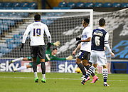 Millwall midfielder Shaun Williams scores from long range and watches the ball this the net during the Sky Bet League 1 match between Millwall and Bury at The Den, London, England on 28 November 2015. Photo by David Charbit.