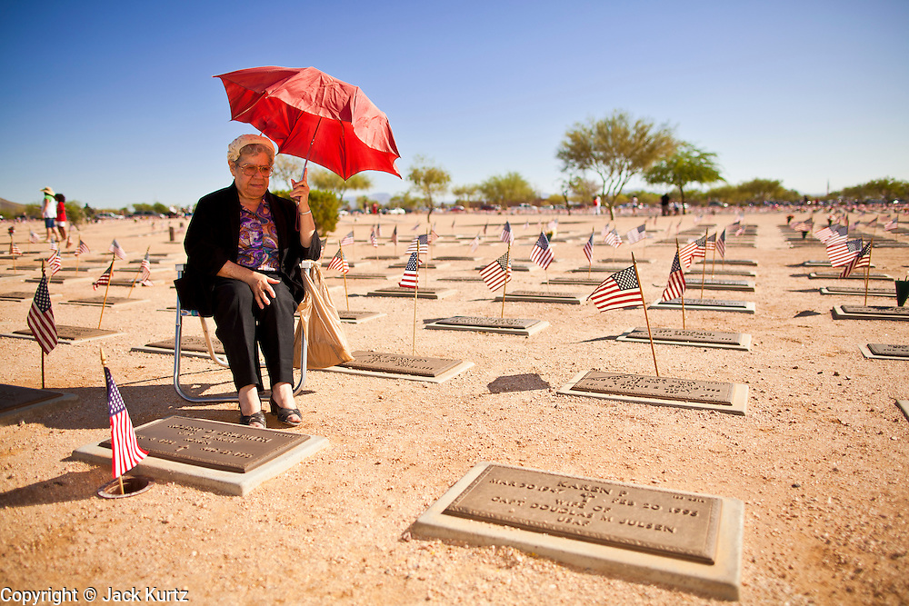 30 MAY 2011 - PHOENIX, AZ:  MARIA BEILSMITH at the grave site of her late husband, a US Army veteran who fought in the Korean War, during Memorial Day services in the National Memorial Cemetery in Phoenix, AZ, Monday. Memorial Day was celebrated with services across the United States Monday.    Photo by Jack Kurtz