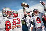 Manti players proudly hold up the Utah High School 2A Football championship trophy after defeating Manti in Pleasant Grove, Saturday, Nov. 10, 2012.