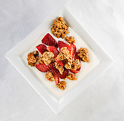 Yogurt, strawberries and granola at The Farmer's Table in Fayetteville, Arkansas. A farm to table, local and organic, restaurant in Northwest Arkansas.<br /> Photo by Beth Hall