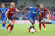 AFC Wimbledon striker Dominic Poleon (10) and Shrewsbury Town defender Jack grimmer during the EFL Sky Bet League 1 match between AFC Wimbledon and Shrewsbury Town at the Cherry Red Records Stadium, Kingston, England on 24 September 2016. Photo by Stuart Butcher.