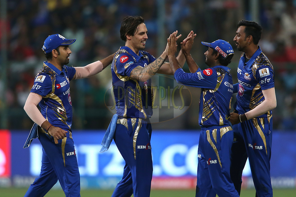 Mitchell Johnson of the Mumbai Indians and Ambati Rayudu of the Mumbai Indians celebrate getting Piyush Chawla of the Kolkata Knight Riders wicket during the 2nd qualifier match of the Vivo 2017 Indian Premier League between the Mumbai Indians and the Kolkata Knight Riders held at the M.Chinnaswamy Stadium in Bangalore, India on the 19th May 2017<br /> <br /> Photo by Shaun Roy - Sportzpics - IPL