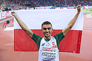 Adam Kszczot from Poland celebrates his victory and gold medal in men's 800 meters final during the Fourth Day of the European Athletics Championships Zurich 2014 at Letzigrund Stadium in Zurich, Switzerland.<br /> <br /> Switzerland, Zurich, August 15, 2014<br /> <br /> Picture also available in RAW (NEF) or TIFF format on special request.<br /> <br /> For editorial use only. Any commercial or promotional use requires permission.<br /> <br /> Photo by &copy; Adam Nurkiewicz / Mediasport