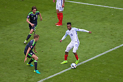 LENS, FRANCE - Thursday, June 16, 2016: Wales' David Edwards and Joe Allen in action against England's Daniel Sturridge during the UEFA Euro 2016 Championship Group B match at the Stade Bollaert-Delelis. (Pic by Paul Greenwood/Propaganda)