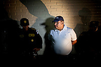 Elgin Enrique Vargas Hernandez, 35, (R) detained for the murder of Argentine folk singer Facundo Cabral is brought before the media at the Torre de Tribunales, Guatemala City, July 12, 2011. Darren Hauck