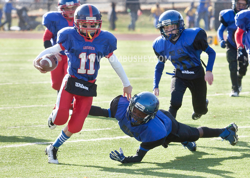 Newburgh, New York - A Goshen player sprints away from a Middletown defender during the Orange County Youth Football League Division II Super Bowl at Newburgh Free Academy on  Nov. 22, 2014.