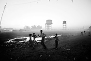 Children play near the site of the deserted Union Carbide factory on November 30, 2009 in Bhopal, India. A quarter century later, many of those who were exposed to the gas have given birth to physically and mentally disabled children...Twenty-five years after an explosion causing a mass gas leak, in the Union Carbide factory in Bhopal, killed at least eight thousand people, toxic material from the 'biggest industrial disaster in history' continues to affect Bhopalis. A new generation is growing up sick, disabled and struggling for justice.