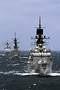 Navy destroyers and Aegis cruiser in.battle line