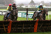 Supasundae and Robbie Power (red cap) and Buveur D'Air with Barry Geraghty (white cap) battle it out at the last hurdle in the 3.25pm The Betway Aintree Hurdle (Grade 1) 2m 4fduring the Grand National Festival Week at Aintree, Liverpool, United Kingdom on 4 April 2019.