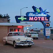 Blue Swallow Motel in Tucumcari, New Mexico with vintage cars