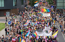 © Licensed to London News Pictures. 13/07/2019; Bristol, UK. Bristol Pride's 10th anniversary in 2019; their biggest ever march with thousands of people march in the Pride Parade through Bristol with the rainbow flag in celebration for all sections of the LGBT community. The festival continues on Bristol Downs with an estimated 35,000 people attending. Photo credit: Simon Chapman/LNP.