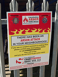 Police sign about Arson