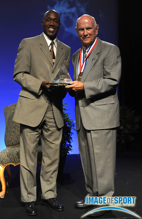 Dec 16, 2009; Orlando, FL, USA; Chuck Rohe (right) is presented by J.J. Clark at the USTFCCCA Convention Hall of Fame induction ceremony.