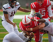 Souderton's Deandre Wakefield #44 is stripped of the ball in the end zone by Hatboro Horsham's defenders in the first quarter of the Hatboro Horsham at Souderton football game Friday, September 06, 2019 at Souderton High School in Franconia, Pennsylvania. (WILLIAM THOMAS CAIN / PHOTOJOURNALIST)